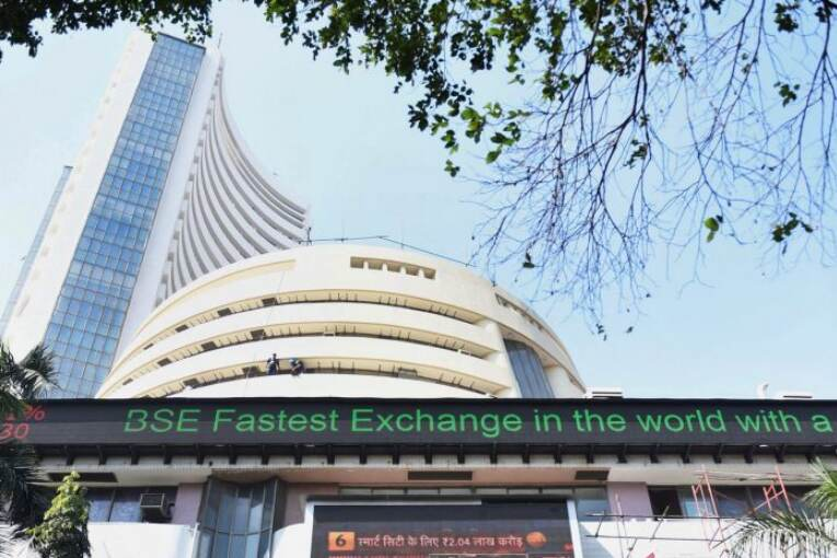 Sensex rallies 460 points, Nifty reclaims 14,800 as RBI holds rates