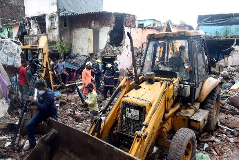 Two building crashes in Mumbai kill 13, 8 children among dead; contractor held